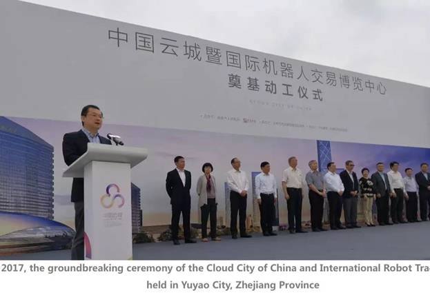 A group of people standing in front of a large white banner Description automatically generated with low confidence